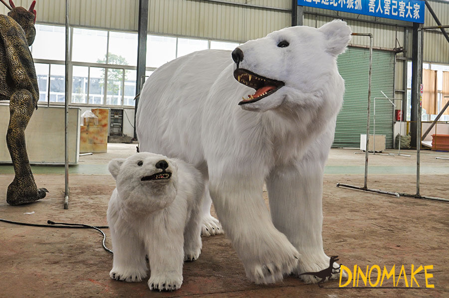 A polar bear with its baby