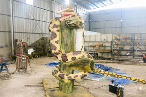 animatronic snake on branch