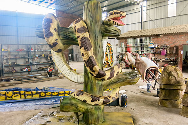 animatronic snake on branch