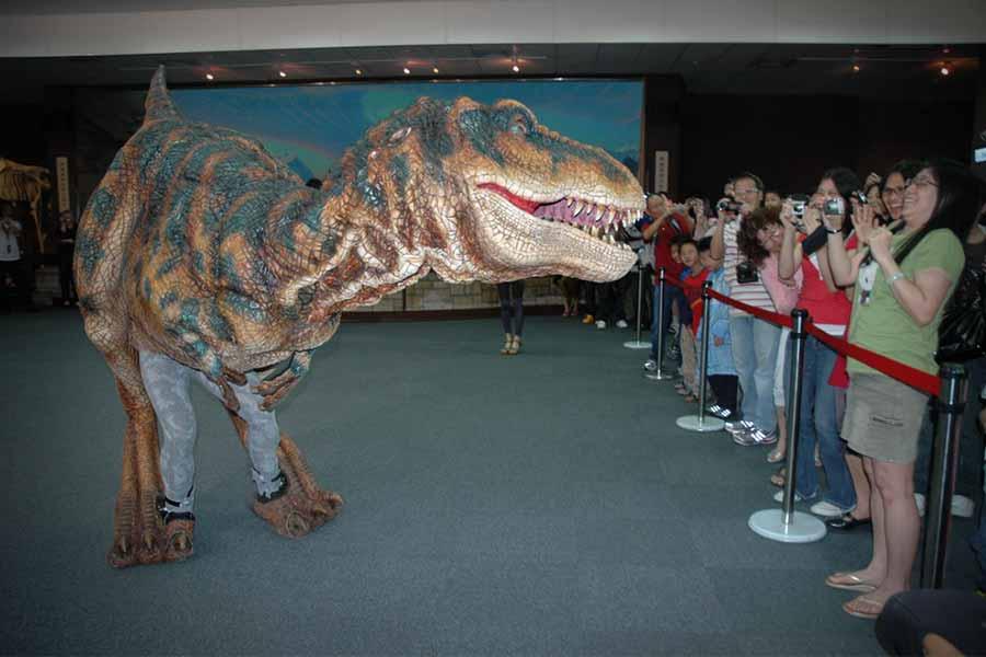 Dinosaur costume performing