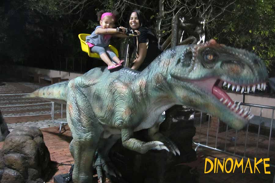 Happy kid with dinosaur ride