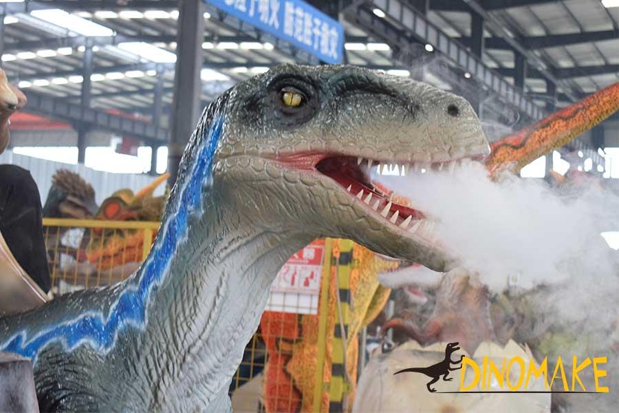 The Velociraptor dinosaur ride is spraying smoke