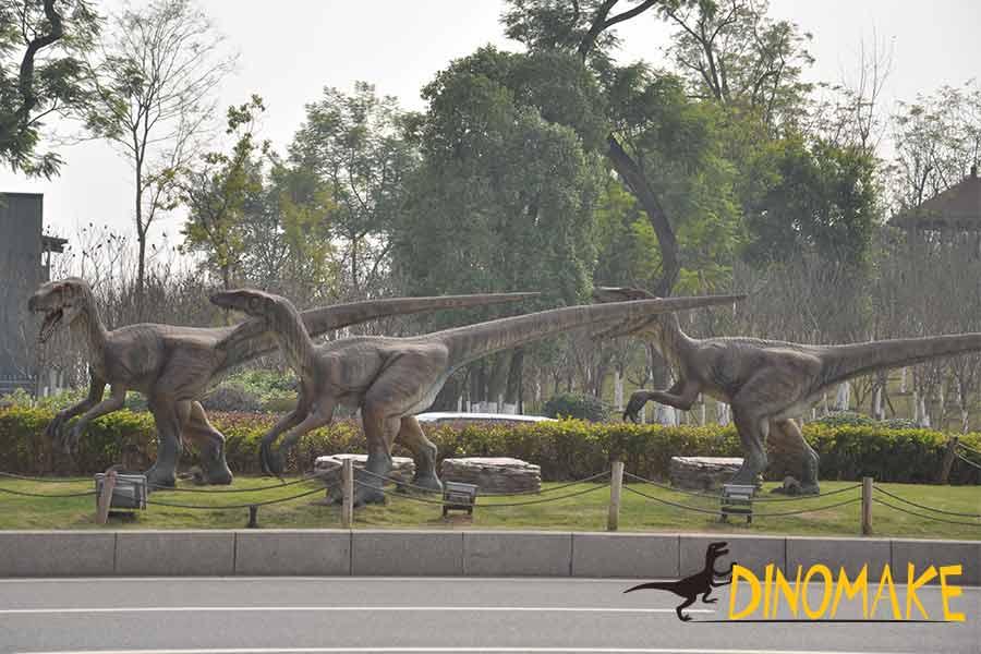 A group of animatronic velociraptor