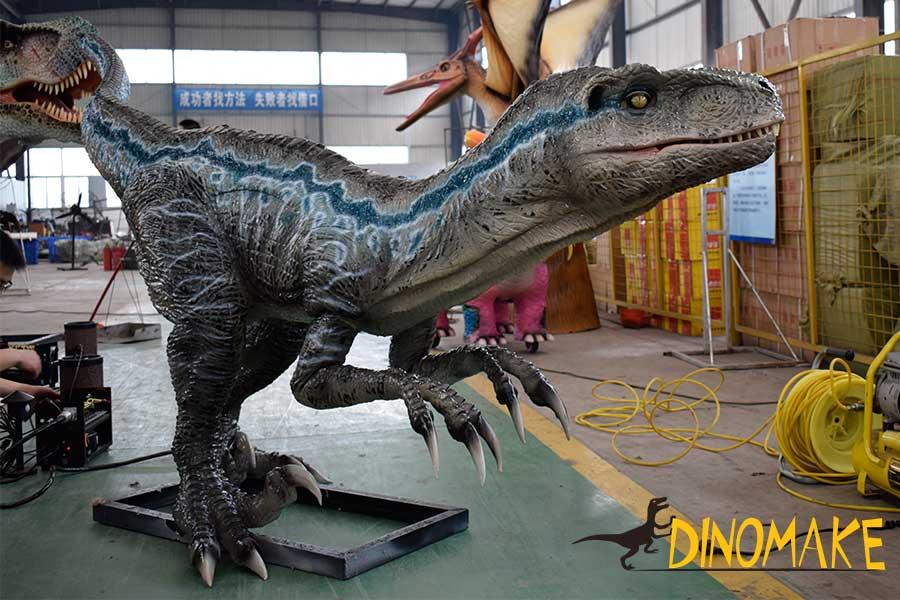 blue velociraptor statue