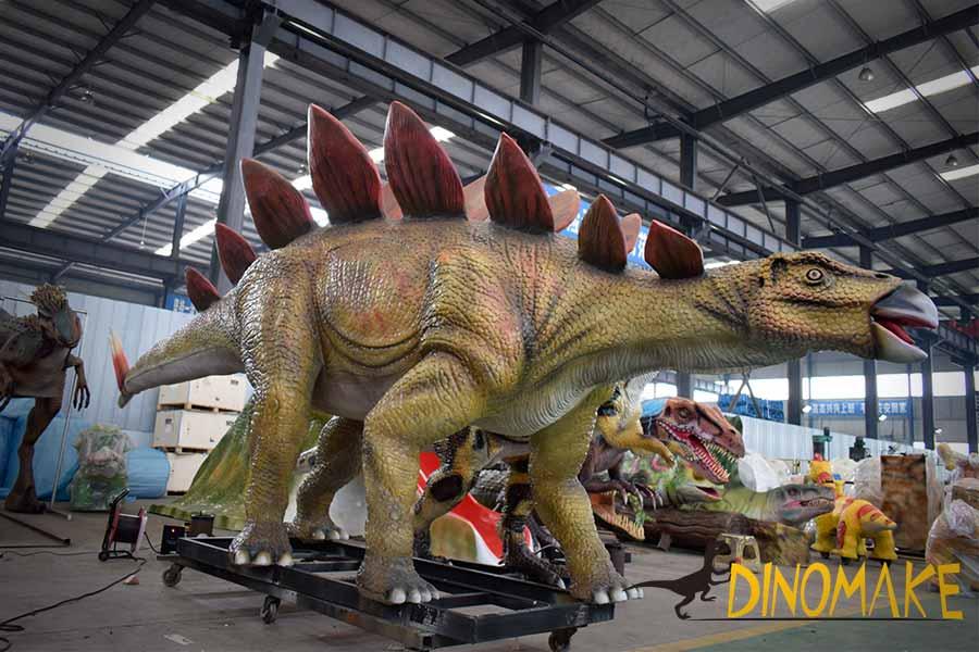 animatronic stegosaurus in the workshop