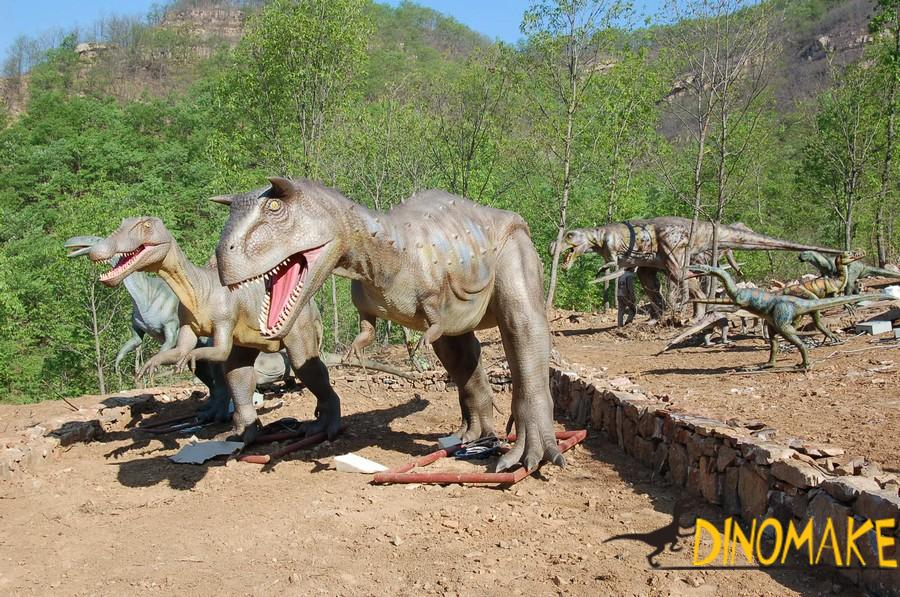 Preparing an animated dinosaur in a park