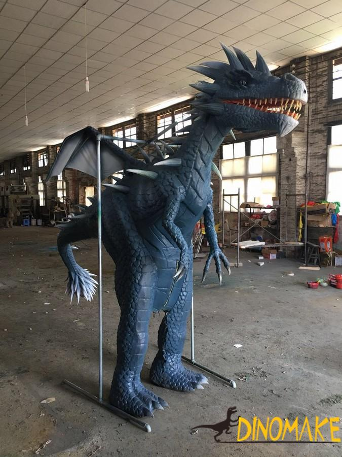 Animatronic costume walking with realistic western dragon suits