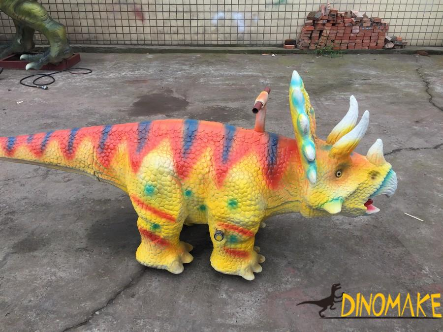 Dinosaur model toy cars in Shopping mall center kiddie rides Triceratops