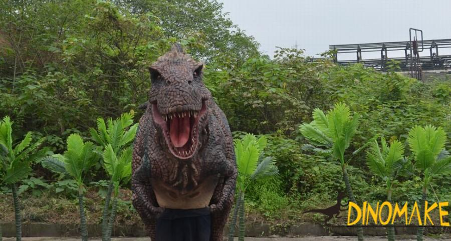 Man wearing animatronic dinosaur costume