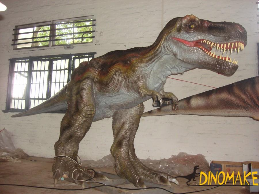 animatronic of dinosaur installation using crane or forklift